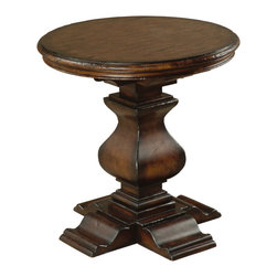 Ambella Home - Aspen Round End Table - Pair this beautifully carved hardwood end table with your cozy sofa for a rustic, yet polished look. Its warm mahogany finish is just waiting for a lamp, your favorite book and a fresh cup of tea. It's the type of heirloom-quality piece that gets better with age — just like you.