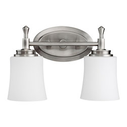 Kichler 2-Light Wall Mounted Bath Light - Brushed Nickel - Two Light Wall Mounted Bath Light Not quite contemporary, not fully traditional - this two light bath fixture envelops Edith Wharton's principles of design. Intriguing concepts of basic shapes complement a brushed nickel finish and satin-etched cased opal glass. 100-w. Max. Width 14, height 10, extension 6. Fixture may be installed with glass up or down. Height from center of wall opening with glass down is 2-3/4. Backplate size: 7-1/2 x 4-1/2. U. L. Listed for damp location