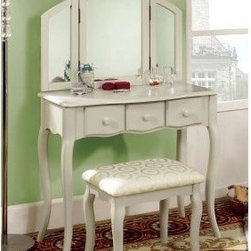Furniture of America Lerraine Bedroom Vanity Set - White - Like a breath of fresh air for your bedroom, the Furniture of America Lerraine Bedroom Vanity Set - White will instantly refresh your space - and make some much-needed room for all of your beautifiers and baubles. Crafted of solid wood, this pretty little vanity touts elegant curves, a matching three-point mirror, as well as a coordinating bench with a padded seat. Available in a fresh white finish with three drawers and color-matched knobs, this set is an ideal addition to complement a cottage chic aesthetic, or perfect for the teen or tween in your life who's looking for something fun yet grown-up and functional.Set Dimensions:Table: 32W x 16D x 30H in.Mirror: 30.75W x 1D x 20.5H in.Bench: 19W x 13D x 17.5H in.About Furniture of America Based in California, Furniture of America has established itself as a premier provider of fine home furnishings. The people behind Furniture of America brand are moved by passion, hard work, and persistence. They're always striving to design the latest piece, keeping in mind their mission to make quality furniture available to urban-minded shoppers, without compromising the packaging integrity. Furniture of America offers unique, coordinated, and affordably designed furniture; they're a one-step resource in the furniture industry for both high-quality pieces as well as secure and professional packaging.