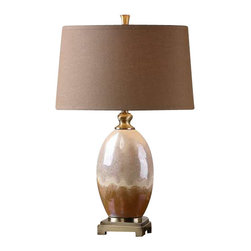 Uttermost Eadric Ceramic Table Lamp - Ceramic base finished in an iridescent ivory and rust brown glaze accented with plated brushed antiqued gold details. Ceramic base finished in an iridescent ivory and rust brown glaze accented with plated brushed antiqued gold details. The tapered oval hardback shade is a rust brown linen fabric with natural slubbing. Due to the nature of fired glazes on ceramic lamps, finishes will vary slightly.