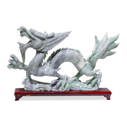 China Furniture and Arts - Hand Carved Jade Flying Dragon - The dragon has long been an auspicious symbol of power in Chinese culture.  According to Chinese feng shui, it is the embodiment of the masculine gender and is said to bring prosperity and good fortune. Vividly hand-carved from ornamental jade, this fine dragon will provide an interesting focus wherever it is placed. Wooden stand included.