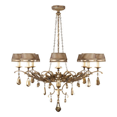 Fine Art Lamps - Golden Aura Chandelier, 755840ST - Does it get any more decadent than golden crystals? Dripping from the bottom of an ornate, aged-gold ironwork frame, the crystals twinkle with a warm, rich light reflected from the candelabra bulbs. Each candle-style light is encircled in a hand-sewn shade pleated with gold metal bandings for a modern touch. It's a unique and elegant option for the dining room.
