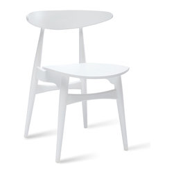 Bryght - Tricia White Dining Chair - The Tricia dining chair effortlessly combines curves and sculptural lines to bring a mid century modern allure to your dining space.