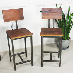 what WE make - reclaimed wood bar stools (set of 2) - Handmade in Chicago from local reclaimed barn wood, these bar stools feature hand-welded steel pipe legs for an industrial look that works with your decor, whether it's transitional or modern. Convenient back rests provide you and your guests with comfortable bar seating.