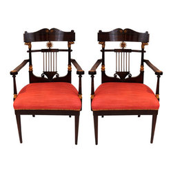 Consigned Set of 2 Armchairs, Russia 19th century - Very rare and unusual set with mahogany and burl wood veneer. The backs of the chairs are decorated with carved and gilded decoration. The chairs are in very good unrestored condition.