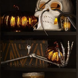 """Halloween Metal Skeleton Hand - This stylishly ghoulish specter sends a chill when spotted on a table or mantel. 19"""" long x 5"""" wide x 5"""" high Made of cast aluminum with an antiqued finish."""