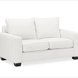 """PB Comfort Square UpholsteredLoveseat Knife-EdgeDenimWarm WhiteUpholsteredPoly - Built by our exclusive master upholsterers in the heart of North Carolina, our PB Comfort Square Upholstered Love Seat is designed for unparalleled comfort with deep seats and three layers of padding. 63"""" w x 40"""" d x 37"""" h {{link path='pages/popups/PB-FG-Comfort-Square-Arm-4.html' class='popup' width='720' height='800'}}View the dimension diagram for more information{{/link}}. {{link path='pages/popups/PB-FG-Comfort-Square-Arm-6.html' class='popup' width='720' height='800'}}The fit & measuring guide should be read prior to placing your order{{/link}}. Choose polyester wrapped cushions for a tailored and neat look, or down-blend for a casual and relaxed look. Choice of knife-edged or box-style back cushions. Proudly made in America, {{link path='/stylehouse/videos/videos/pbq_v36_rel.html?cm_sp=Video_PIP-_-PBQUALITY-_-SUTTER_STREET' class='popup' width='950' height='300'}}view video{{/link}}. For shipping and return information, click on the shipping tab. When making your selection, see the Quick Ship and Special Order fabrics below. {{link path='pages/popups/PB-FG-Comfort-Square-Arm-7.html' class='popup' width='720' height='800'}} Additional fabrics not shown below can be seen here{{/link}}. Please call 1.888.779.5176 to place your order for these additional fabrics."""