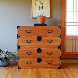 2 section kiri wood isho dansu. Japanese style clothing chest, dresser, tansu - Our handcrafted artisans chest made of Paulownia wood (known in Japanese as kiri), this environmentally friendly fast growing wood is very light weight, fine-grained, soft, and warp-resistant.   Fine detailing including dovetail joinery throughout, and traditional iron hardware make this chest a handsome and practical addition to most any interior.  Ideal for organizing clothing, crafts, office supplies, or jewelry.  This Isho tansu, traditionally used as a clothing chest, is fabricated in two (2) sections and features a mix of sliding doors, and six (6) large drawers have side mounted glides.  Customization available.