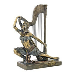 Design Toscano 10 in. Song of the Nile Egyptian Dancer Statue - To encourage and celebrate the life-giving Nile River, ancient rituals of music and dance paid homage to the water gods, and in this Design Toscano 10 in. Song of the Nile Egyptian Dancer Statue, an Egyptian dancer kneels in one of the mystical performances created and performed in the great temple. Cast in quality designer resin this 1920's Egyptian revival statue is hand-finished in faux bronze.About Design ToscanoDesign Toscano is the country's premier source for statues and other historical and antique replicas, which are available through the company's catalog and website. Design Toscano's founders, Michael and Marilyn Stopka, created Design Toscano in 1990. While on a trip to Paris, the Stopkas first saw the marvelous carvings of gargoyles and water spouts at the Notre Dame Cathedral. Inspired by the beauty and mystery of these pieces, they decided to introduce the world of medieval gargoyles to America in 1993. On a later trip to Albi, France, the Stopkas had the pleasure of being exposed to the world of Jacquard tapestries that they added quickly to the growing catalog. Since then, the company's product line has grown to include Egyptian, Medieval and other period pieces that are now among the current favorites of Design Toscano customers, along with an extensive collection of garden fountains, statuary, authentic canvas replicas of oil painting masterpieces, and other antique art reproductions. At Design Toscano, attention to detail is important. Travel directly to the source for all historical replicas ensures brilliant design.