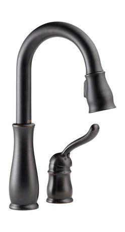 Delta Single Handle Bar/Prep Faucet - 9978-RB-DST - The Leland Bath Collection gracefully reinterprets the time-honored teapot design with decorative, traditional detailing.