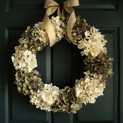 Antiqued Hydrangea Wreath from HomeHearthGarden - A soft touch antiqued looking hydrangea wreath crafted with artificial antique white hydrangeas and green hydrangeas with an ivory ribbon bow on a natural grapevine wreath base. A nice accent for wedding decoration, home decor, and front door wreath.