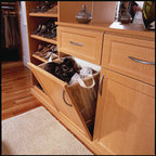 Tilt-out Removable Hamper - Tilt-out hamper and removable laundry bags for a custom-designed walk-in closet.