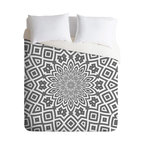 Lisa Argyropoulos Helena King Duvet Cover - Bedeck your bed with a kaleidoscopic print in a subtle color combo that won't keep you awake at night. But beware — the super-soft material will tempt you to sleep in.