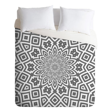 DENY Designs - Lisa Argyropoulos Helena King Duvet Cover - Bedeck your bed with a kaleidoscopic print in a subtle color combo that won't keep you awake at night. But beware — the super-soft material will tempt you to sleep in.