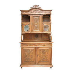 "Pre-owned Vintage French Louis XVI Carved Oak Buffet Hutch - Crafted in France just prior to the onset of World War II, this vintage Louis XVI style buffet hutch is an excellent example of quality craftsmanship.  In oak and standing at just over eight feet high it can accommodate dinnerware, collectibles, or your music and movie collection in unparalleled style.    Overall Condition is Good. Shows normal wear to finish and miscellaneous scratches, nicks, and dings due to age and use. There is wood separation on the top surface, minor speckling to the mirror, and the metal trim around the knob on the right top door is missing. The lock in the upper right cabinet door does not work, but the door opens and closes properly.    This piece is circa 1930.  Overall measurements (inches): 98""H x 51.25""W x 21""D."
