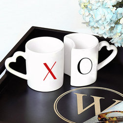 None - XOXO Coffee Mug Set - Add a little bit of romance to your mug collection with this charming set of XOXO coffee mugs. Featuring a red 'X' and black 'O' on uniquely shaped interlocking mugs, this fun his and hers mug set is great for any couple.
