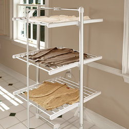 Frontgate - Three-tier Electric Drying Rack - Holds up to 30 lbs. of wet laundry. Lightweight and easy to move. Folds away for convenient storage. 5 ft. cord; 120V. View product manual (PDF format). Enjoy the benefits of air-drying your clothes in half the time with our Three-tier Heated Drying Rack. Perfect for sweaters, jeans and delicates, it features built-in heating coils that reach a temperature of up to 113ºF—providing enough heat to warm and dry even the thickest garments.  .  .  .  . .