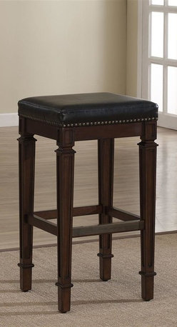 American Heritage - Monaco Bar Stool (Counter Height Stool) - Choose Stool: Counter Height StoolFinished in Navajo with a comfortable High Gloss Black Bonded Leather Cushion. This Wood Stationary stool is Consumer Assembly with Adjustable Leg Levelers. Brass foot plate. 1 Year Warranty. Clean with a damp cloth; warm water only. Counter Height Stool: 16 in. W x 16 in. D x 26 in. H (23 lbs). Bar Height Stool: 16 in. W x 16 in. D x 30 in. H (24 lbs). Assembly Instructions