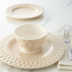 """NM EXCLUSIVE - 12-Piece Quilted Dinnerware Service - CREAM - NM EXCLUSIVE12-Piece Quilted Dinnerware ServiceDetailsWe've seen quilting on everything from bedding to clothing and furniture. Now the motif makes its presence known on dinnerware adding texture and dimension to this solid-color dinnerware set. The pedestal bowl adds another charming note.Handcrafted of earthenware.Dishwasher and microwave safe.Set includes four 11""""Dia. dinner plates four 9""""Dia. salad plates and four 5.5""""Dia. x 3.25""""T bowls.Made in Portugal."""