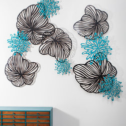 "Melissa Borrell - Pansy and Starburst Wall Pieces, 10-Piece - Inspired by forms from nature, these floral shapes are laser cut from wood and mounted on the wall with spacers so that they float 2-3"" away from the wall to create a dimensional mural.  The set can be arranged as you'd like, but also comes with templates to lay the pieces out in a few different ways."