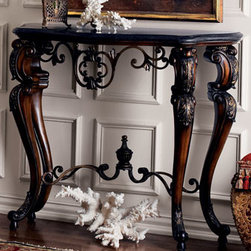 "Ambella - Ambella ""Florentine"" Console - The ""Florentine"" Console begins with a fossil-stone veneer top supported by scrolling carved resin legs with a brown finish and bronze accents. The four legs are spanned by elegant iron scrolls with an antiqued bronze finish in this striking console....."