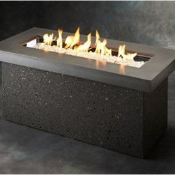 "Outdoor GreatRoom Key Largo Fire Pit Table - Fire may have been the invention of the cave man but the Outdoor GreatRoom Key Largo Fire Pit Table uses all-modern technology for your own outdoor man (or woman) cave. The rectangular Supercast top has a 42-inch linear crystal fire burner that holds the included diamond glass fire gems. The no-fuss electronic piezo controls allow for an adjustable flame height and the outdoor-grade gray base stores one 20-pound liquid propane tank (not included) inside. A supercast tabletop with a Midnight Mist finish completes the design and a natural gas conversion kit also comes included. About Outdoor GreatRoom CompanyWith over 50 patents to its name the Outdoor GreatRoom Company is one of the most innovative names in gas fireplaces and outdoor design period. Since 1975 Dan Ron Steve and Ger have produced a yard of amazing products like the Heat-N-Glo that have changed the industry. In fact they want to change the way you think about your backyard or patio. It's about bringing the luxury and comfort of the living room outside to make an """"Outdoor Room."""" They want you to literally think outside the box. To make that beautiful concept a reality Outdoor GreatRoom designs manufactures and sells pergolas outdoor kitchens grills outdoor furniture fireplaces fire pits lighting and heating products. There's no better name in outdoor leisure than this fine Minnesotan company."