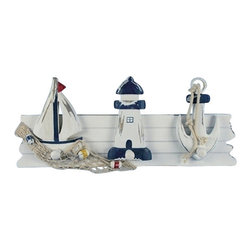 "Sailboat, Lighthouse & Anchor Hanger - The sailboat, lighthouse  anchor hanger measures 16.5"" x 6.75"" x 2.5"". This item is made of wood and is distressed blue  white in color. It will add a definite nautical touch to whatever room it is placed in and is a must have for those who appreciate high quality nautical decor. It makes a great gift, impressive decoration  will be admired by all those who love the sea."