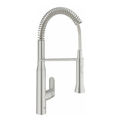 Grohe - Grohe K7 Pre-Rinse Kitchen Faucet w/ Spring Spout & Locking Spray Control - Product Features:    All-brass faucet body construction ensures durability for a lifetime  Covered under Grohe's limited lifetime warranty  Grohe faucets are exclusively engineered in Germany  Finishes will resist corrosion and tarnishing through everyday use - finish covered under lifetime warranty  Locking Dual-Spray Control - switches back and forth between regular flow and spray  Professional spray  Single handle operation  Pullout spray faucet head enhances faucets versatility  Spout swivels 140-degrees providing greater access to more areas of the sink  High-arch gooseneck spout design provides optimal room under the faucet for any size task  ADA compliant - complies with the standards set forth by the Americans with Disabilities Act for kitchen faucets  Low lead compliant - meeting federal and state regulations for lead content    Product Technologies / Benefits:    Starlight Finish: Continuously improving over the last 70 years Grohe�s unique plating process has been refined to produce and immaculate shiny surface that is recognized as one of the best surface finishes the world over. Grohe plates sub layers of copper and/or nickel to ensure that a completely non-porous, immaculate surface awaits the chrome layer. This deep, even layered chrome surface creates a luminous and mirror like sheen. Grohe finishes are life tested to withstand 60,000 �wipes� with an abrasive cloth.  SilkMove Cartridge: The rich and smooth handling of our single lever faucets conveys pure quality. As you change the temperature from hot to cold, one ceramic disc glides effortlessly across the other with absolute precision. These cartridges are manufactured in a high-tech process and feature discs made from a space-proven ceramic alloy. The SilkMove cartridge is yet another example of design and technology fusing to bring you an enhanced water experience.    Product Specifications:    Overall Height: 21