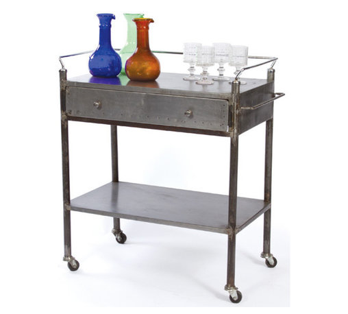 Industrial Trolley - The 36 inch tall Industrial Trolley features a wide single metal drawer and an open shelf assembly. The Whole structure is made of quality steel that is given vintage steel finish. The Industrial Trolley resembles the design of hospital or chemical factory trollies of old times. The steel railing around the top prevents the accidental falling of items. The wide handles of the Industrial Trolley makes the installation and portability easy. The steel trolley can be easily maintained and has fairly higher life span than that of the wooden trollies which makes it a perfect furniture item for industrial use.