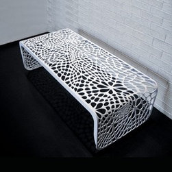 Arktura - Arktura | Coral Table/Bench - Design by Arktura.The Coral Table/Bench is a versatile, practical piece of furniture with a modern twist. The algorithmically-generated, laser cut pattern extends along the full length of the form, and provides a visually complex experience. Constructed from radius bent steel and powder coated in four exciting color options. Also available in a Side Table or Bench models. Suitable for indoor/outdoor use.The Coral Table/Bench is produced with wind and solar power, as are all products from Arktura. Their approach to sustainability begins with a commitment to make quality products that last for a lifetime; and continues into their manufacturing process. Many Arktura products are made of recycled steel and aluminum, which in some pieces contains up to 100% recycled content. And all metallic pieces produce zero landfill waste from manufacture.