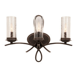 Kalco Lighting - Kalco Grayson 3-Light Bath - Shown in Heirloom Bronze finish with Seeded Glass. The Grayson Collection was inspired by the popular French fleur-de-lis. This collection combines a stylized fleur-de-lis with the Kalco's exclusive lighting shade options. The Hand-cut Calcite and the Hand-crafted Natural Iridescent Shell and Penshell exclusive to Kalco Lighting are all available in this collection. The delicate curves combine with natural shades to create a traditional style that is still elegant and modern.   Overall size is 22 in. W x 6 in. D x 16 in. H.