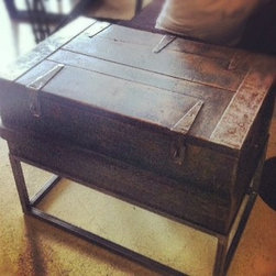 Trunk - Salvaged antique trunk, re-designed into a cool industrial style end table. Raised by a custom steel base, has great storage too.