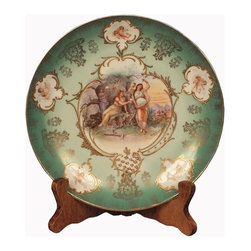 Green Royal Vienna Plate - This is an antique vienna plate, depicting figures of ladies in the center, around the border there are 5 panels of cupids and gilded tracery decoration.