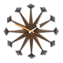 Vitra - Nelson Polygon Wall Clock - By George, this clock has it all! The midcentury modern classic was designed by George Nelson and features a 17-inch diameter body of solid walnut with geometric metal finials. Batteries ensure the colorful minute and hour hands constantly move forward in retro style.