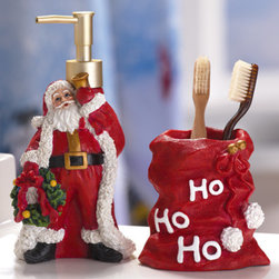 Santa Claus Holiday Bathroom Accessory Set - Deck the guest bathroom with holiday cheer. A Santa Claus soap dispenser and toothbrush holder are the perfect finishing touches for the holidays. To make things even better, fill up your dispenser with yummy cinnamon-scented soap. Your guests will love it.