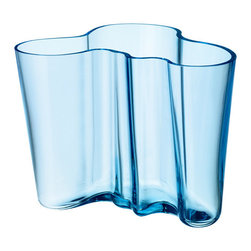 "iittala Aalto Light Blue Vase - 6-1/4"" - Sparkling like the sea, iittala's beautiful translucent Light Blue classic Aalto vase mimics the Finnish coastline in both color and in shape. An original hue for 2011, this color gives the vase a vintage look of antique glass."
