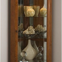 Pulaski - Corner Curio Cabinet with Mirrored Back - Illuminate any corner of your Home with this impressive Curio from Pulaski. Slim enough to fit in the hallway, this attractive and stylish piece is also perfect for the dining area or any room of your home. Adjustable glass shelves and front glass door make it convenient to place your valuables in just the right spot. Comes in a beautiful Golden Oak II finish.