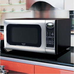 """Sharp - R520KST Countertop Microwave in Stainless Steel - Features: -Stainless steel exterior -2.0 cu. ft., 1200 Watts -7 digit, 2-color lighted display -16"""" diameter turntable -Built-in night light -20 automatic settings -9 Smart & Easy Sensor Settings -3 reheat options for popular food and beverages -4 defrost options for poultry and meat, by weight -Keep Warm Plus function -Popcorn Sensor -Minute Plus function -Kitchen timer -Interior light -AC line voltage: 120V, Single Phase, 60 Hz, AC Only -AC power required: 1.700 kW, 14.3 Amps -Interior dimensions: 10.5""""H x 17.375""""W x 18.625""""D -Exterior dimensions: 13.375""""H x 24""""W x 19.125""""D When you have a large family, you need large appliances to help you complete your meals! This full-size microwave oven includes 9 Smart & Easy Sensor Settings adjust the right time and power levels automatically for 9 popular microwave favorites including popcorn, fresh vegetables, frozen entrees, rice, baked potatoes, ground meat, poultry, fish and seafood. A 16"""" diameter turntable allows for large casserole dishes. This oven also features the very innovative built-in night light, to help you out when those late night cravings hit!"""