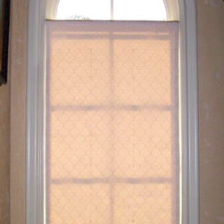 Shades and Blinds - This is an functional roman shade mounted inside the window frame.