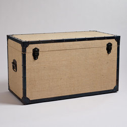 Burlap Steamer Trunk - This trunk would not only serve as great storage, but function as a coffee or side table as well. I love the natural material with the striking black border.