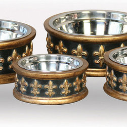 Frontgate - Chartres Dog Bowl by Unleashed Life - Charcoal resin bowl. Embossed fleur-de-lis emblem. Includes stainless steel bowls. Hand wash. Inspired by the rich history of New Orleans, our Chartres Dog Bowl by Unleashed Life is gorgeously adorned with antique gold trim. The graceful, richly embossed design complements classic French country to more formal living styles.  .  .  .  .