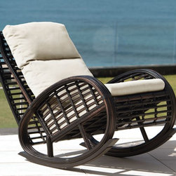 Taurus Outdoor Rocking Chair from Skyline Design - The Taurus Outdoor Rocking Chair features a unique and elegant design, indicative of the innovation and quality that has made Skyline Design the leader in luxury outdoor furniture.  Integrating the finest synthetic weaving materials with strong aluminum frames, Skyline Design creates furniture that is as beautiful as it is durable.  Utilizing revolutionary high-density polyethylene weaving material, Skyline Design furniture is high-tensile strength, chemical and UV resistant, all-weather proof furniture that is safe for the environment and 100% recyclable.