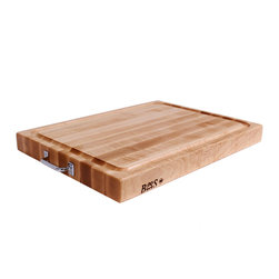 BoosBlock Reversible Maple Cutting Board - The handles and substantial size of this board make it a keeper. This manufacturer is the gold standard in butcher block we use their products in kitchens regularly.