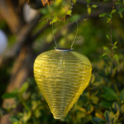 Allsop Teardrop Moss Lantern - Bring a touch of Asian elegance to your backyard or garden with this Silk Effect Solar Lantern. These beautiful tear drop lanterns combine shimmering, sheer silk fabric in sophisticated earthy colors with a traditional Asian lantern shape. Designed for outdoor use, these solar powered lanterns collect light all day and turn themselves on at dusk. Each lantern is equipped with dual white high powered LED lights, solar panel, AAA rechargeable solar battery and stainless steel hardware that is easy to assemble. Make every evening in your garden festive with this beautiful handmade lantern.  Available colors: Bronze, Moss, Pearl, and Slate. Dimensions: 12H x 10W x 10D