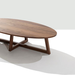 Finn Low Oval Coffee Table - Finn is a solid wood table with angled frame-style legs. The intersection at the base anchors the design to the floor and contrasts with the visual lightness of the tabletop. A great design to pair with clean-lined contemporary upholstery and modern classic styles.