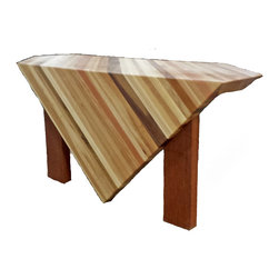 Circle Goods - Sculpture Base - This piece was made with a butcher block top and reclaimed mahogany legs. It is a piece that would show a sculpture or piece of art very nicely. You could even say it is a sculpture in itself, with wild angles and top that has been carved into the legs it is one of a kind.