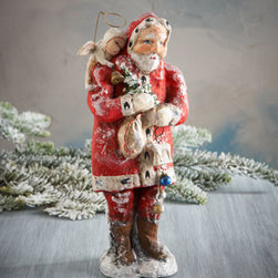"Debbee Thibault - Debbee Thibault Good Tidings Santa - Inspired by vintage toys, this nostalgic Santa arrives loaded with Christmas decorations and accompanied by a tiny angel on his shoulder. Made of papier-mache. Hand painted. 9""T. Made in the USA."