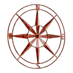 Polaris Wall Decor - Bring travel themes or nautical details to your decor or simply introduce high-contrast color to a collection of complex, distressed finishes with the Polaris Wall D�cor, a compass rose made from dimensional metal painted red and flecked by rust and wear.  The spokes of this wall art piece form a dramatic star against your wall color for a richly geometric look.
