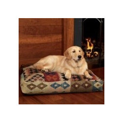 Persian Kilim Napper Dog Bed - Don't forget the pets! I have cats, so they sleep wherever they please, but for those of you with fur-kids who need a bed, this kilim bed oughta do the trick.
