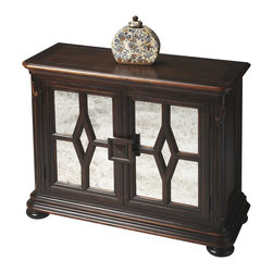 Butler Specialty Furniture - Connoisseur'S Console Cabinet 1143090 - Handcrafted from gmelina wood solids, wood products and choice maple veneers, this attractive console cabinet features a tiered base and an immaculate window panel design with arresting antique-mirror treatments on door panels. Boasts ample storage with an adjustable shelf behind the doors. Lightly distressed, antiqued dark walnut finish. Only listed product included.